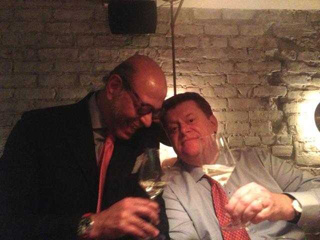two men drinking wine