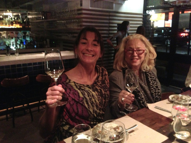 two ladies toasting
