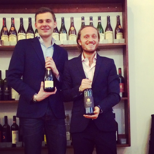 two men holding wine
